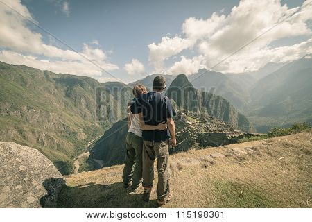 Hugging Couple Looking At Machu Picchu, Peru, Toned Image