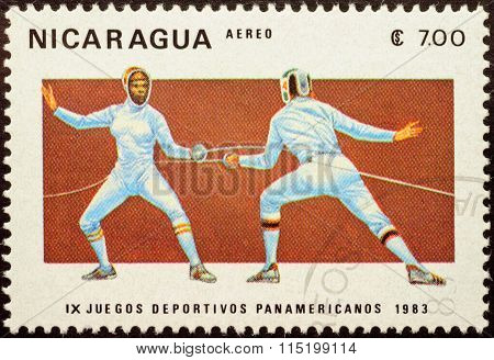 Duel Of Two Fencers On Post Stamp