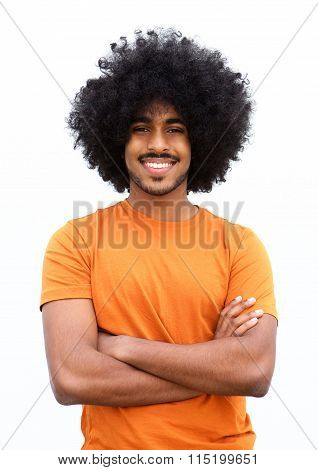 Black Guy Smiling With Arms Crossed Against White Background