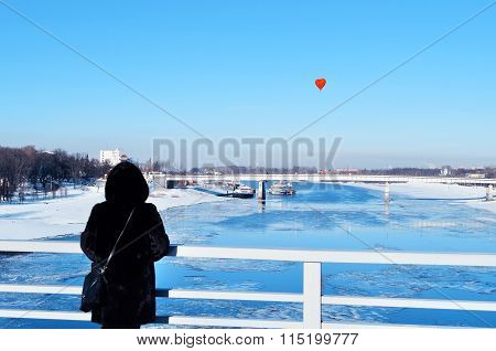 Heart-shaped Balloon From The Bridge In Sunny Winter Afternoon. Romantic Concept.