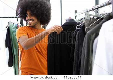 Male Shopper Looking For Clothes