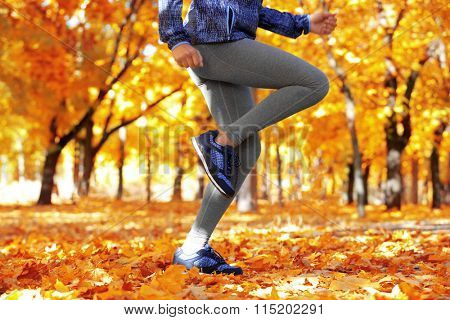 Runner legs outside during autumn day.