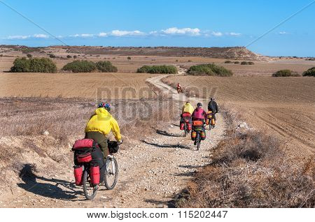 Cyclists Riding On Mountain Serpentine