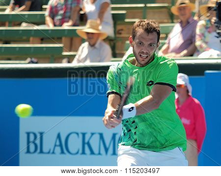Paul-Henri Mathieu Of France hits a backhand