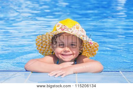 Little girl smiling in swimming pool