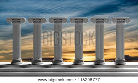 Six ancient pillars with sunset sky background.