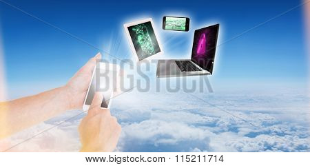 Woman using smartphone against blue sky over clouds at high altitude