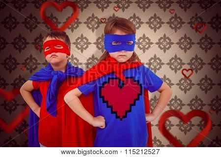 Masked kids pretending to be superheroes against love heart pattern