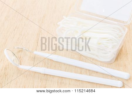Oral Device : Dental floss on wooden background