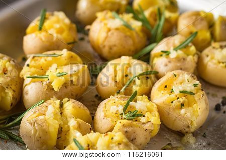 Roasted potatoes on a cooking tray, close up