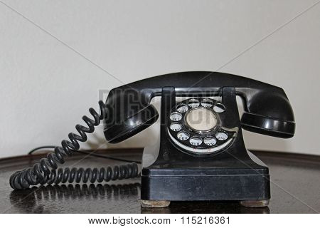 Vintage black telephone with dial