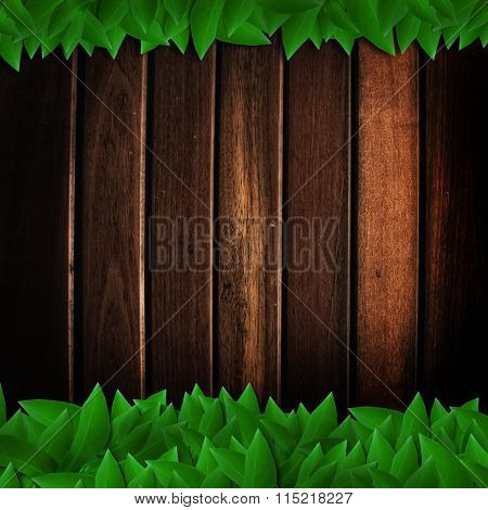 The green leaves isolated on wooden texture background
