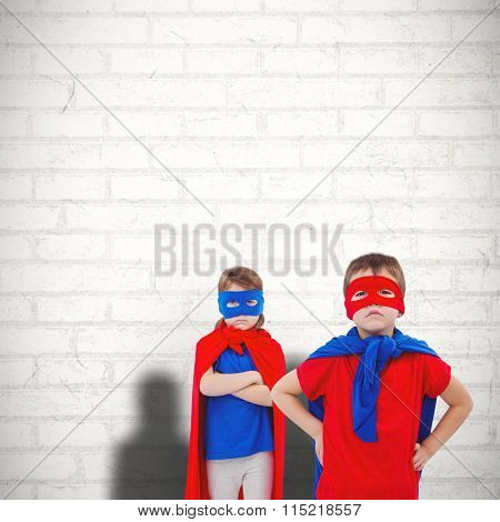 Masked kids pretending to be superheroes against white wall