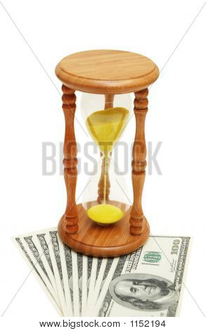 """Time Is Money"" Concept - Hourglass And Dollars"