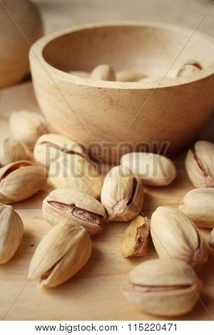 Pistachios Nuts On A Background Of Brown