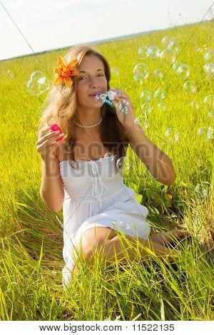 Girl In White Dress Making Soap Bubbles