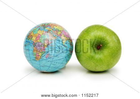Globe And Green Apples Isolated On White