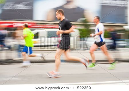 Krakow, Poland - May 18 : Cracovia Marathon. Runners On The City Streets On May 18, 2014 In Krakow,