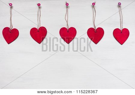 Wooden Red Hearts On White Background