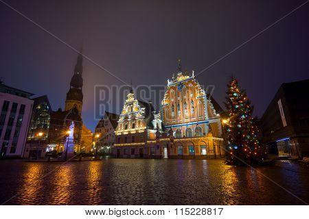 RIGA, LATVIA - DECEMBER 19, 2015: Illuminated house of the Blackheads at night on December 19, 2015 in Riga, Latvia