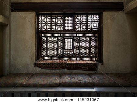 CAIRO, EGYPT - September 2012: Aged Interleaved Wooden Window (mashrabiya) And A Built-in Couch