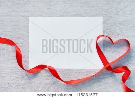 Frame or gift card with valentines heart shaped ribbon