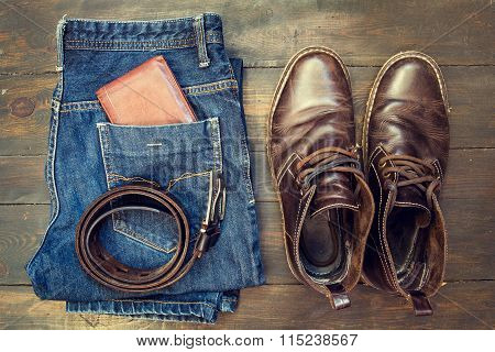 Jeans, Belt , Shoes And Wallet On Wooden Background