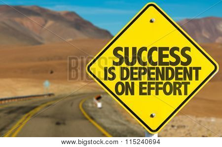 Success Is Dependent on Effort sign on desert road