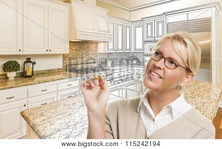 Creative Woman With Pencil Over Custom Kitchen Design Drawing and Photo Combination.
