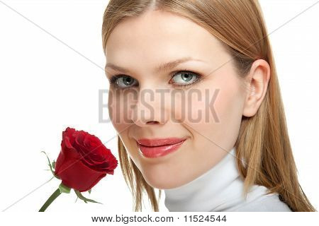 Young Beautiful Woman With A Single Red Rose