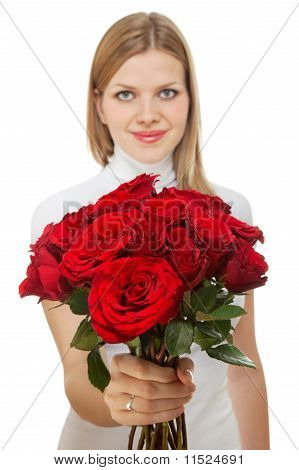 Young Beautiful Woman With A Bunch Of Roses