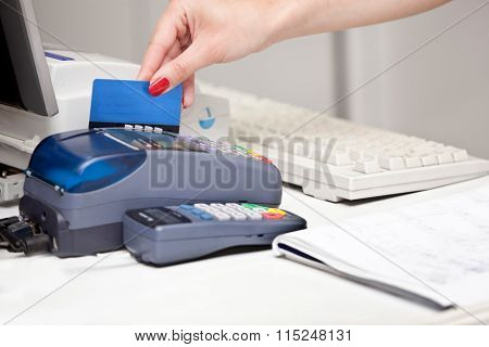 Pos Terminal Transaction. Hand Swiping A Credit Card.