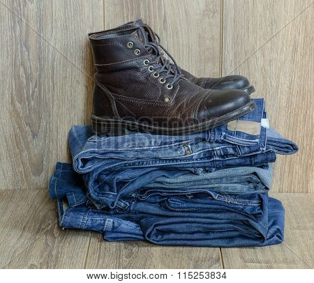 Pile Of Jeans And Boots