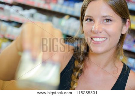 Lady serving blurred packet of cigarettes
