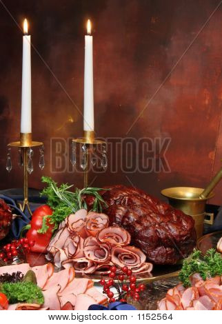 Group Of Meat On Holiday Table With Candles