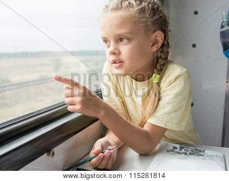 Girl Shows A Finger In The Second-class Car Of A Train Window