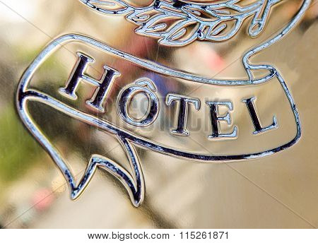 Hotel Word Engraved On Golden Plate