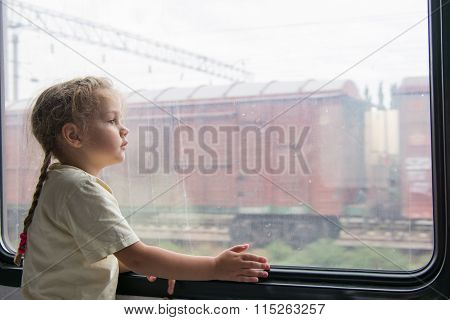 Girl Thoughtfully Looking Into The Distance From A Train Window