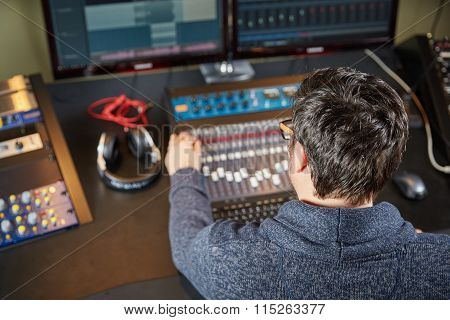 Audio Technician Working In Sound Studio