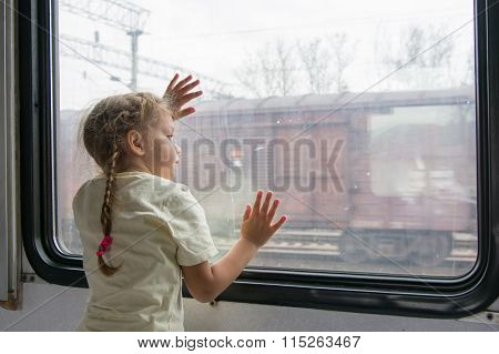 The Girl Looks Into The Distance From The Window Of A Train Car