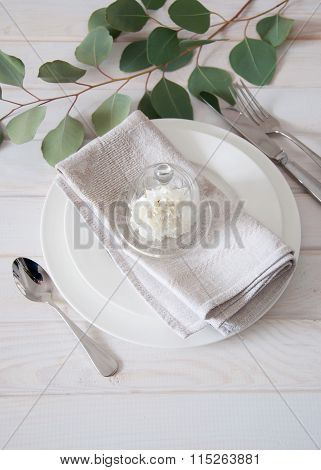 Elegantly Served Table With Linen Napkins And Silverware