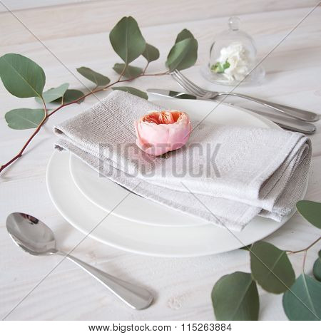 Decorated Table Setting With Linen Napkins, Rose And White Carnation Flowers And Silverware