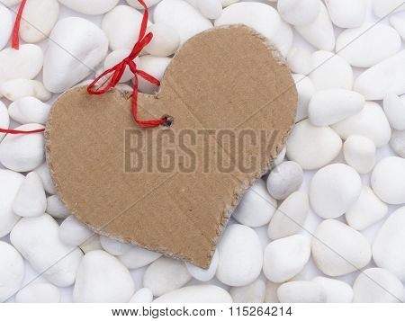 heart shape tag on the white stones