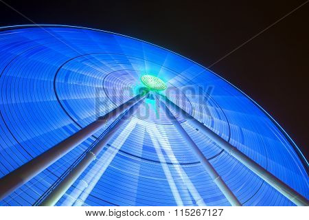 Lights shine from giant spinning wheel