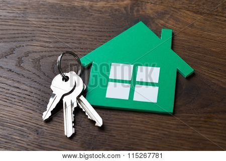 Green Paper House And Keys On Table