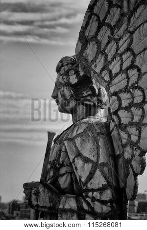 MONTREAL, CANADA-AUGUST 20th, 2014: Profile of an angel statue on the top of the chapel Notre-Dame-Du-Bon-secours in black and white in Montreal, Canada