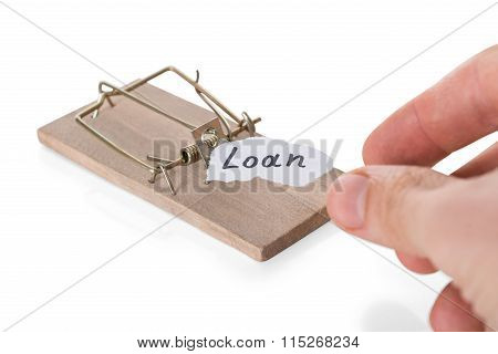 Cropped Hand Reaching Loan Sign On Mousetrap