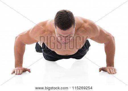 Determined Muscular Man Doing Push Ups