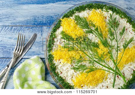 Salad With Sardines Mimosas On A Blue Wooden Background