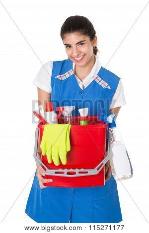 Happy Female Janitor Carrying Bucket With Cleaning Equipment